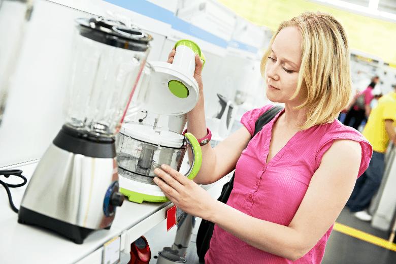 Woman Shopping For Kitchen Appliances
